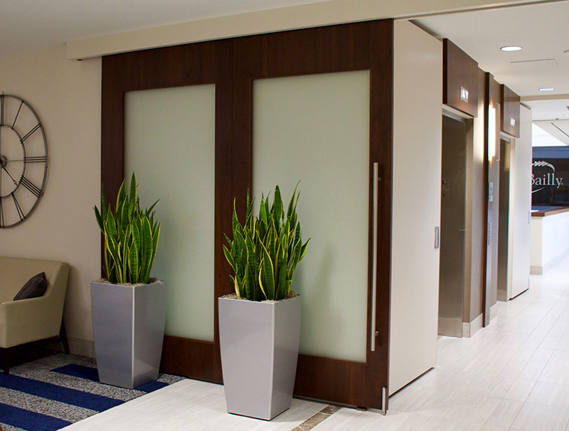 Handsome Barn Doors And Immaculate Hardware Complement A Variety Of Spaces  From Office Meeting Rooms To Restaurant Partitions.